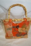 Orange felt bag with cane handles