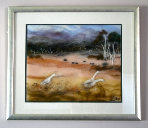 Wool felt art painting of geese in a field of ti trees
